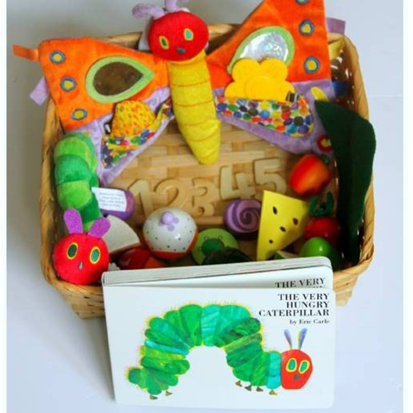 Win an Eric Carle Signed Print and Gift Basket Filled with Toys and Books